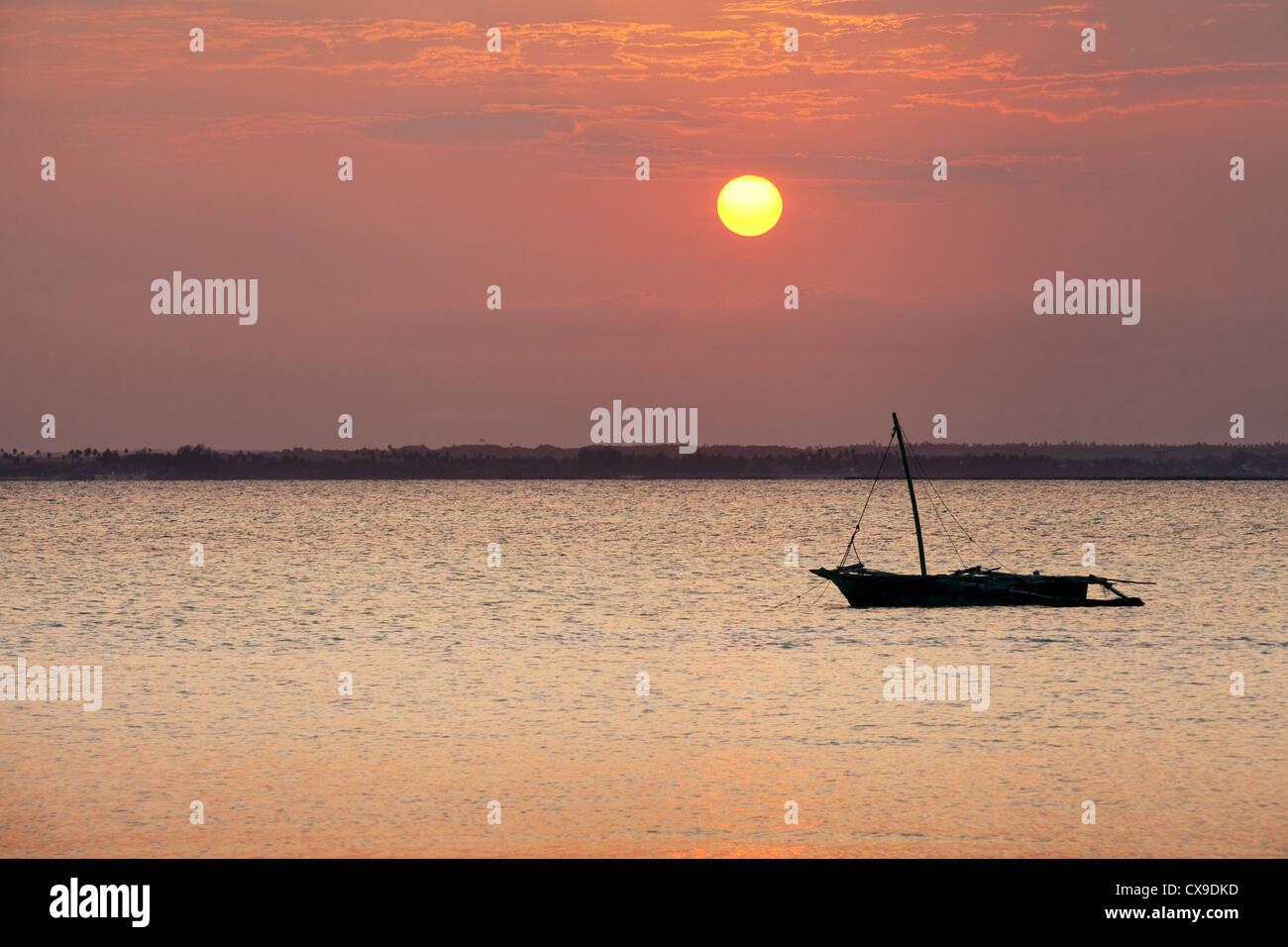 Dhow moored at sunset, Michamwi, Zanzibar Africa - Stock Image