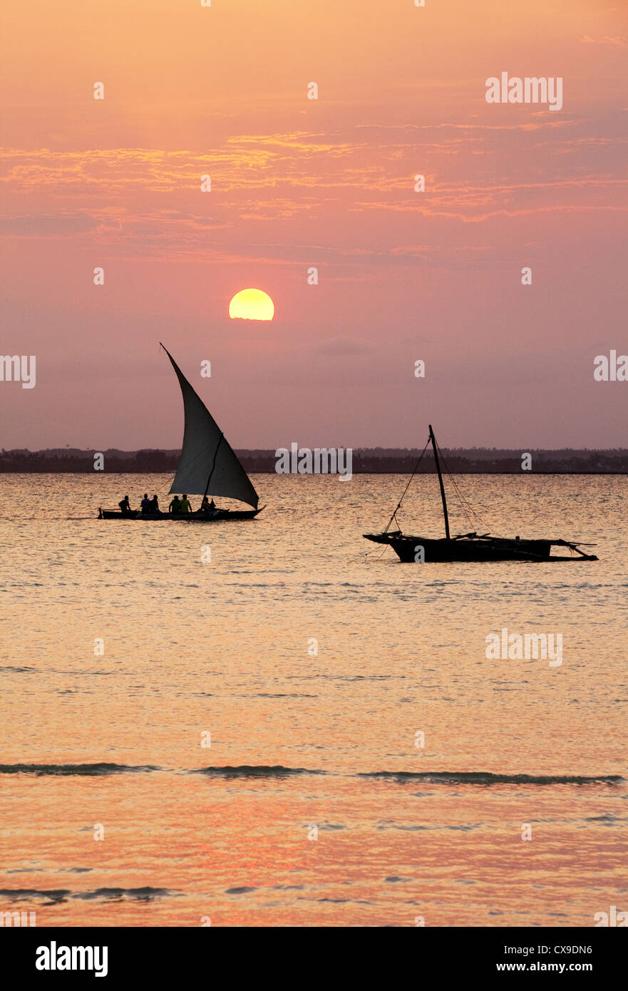 Two dhows at sunset, Michamwi, Zanzibar Africa - Stock Image