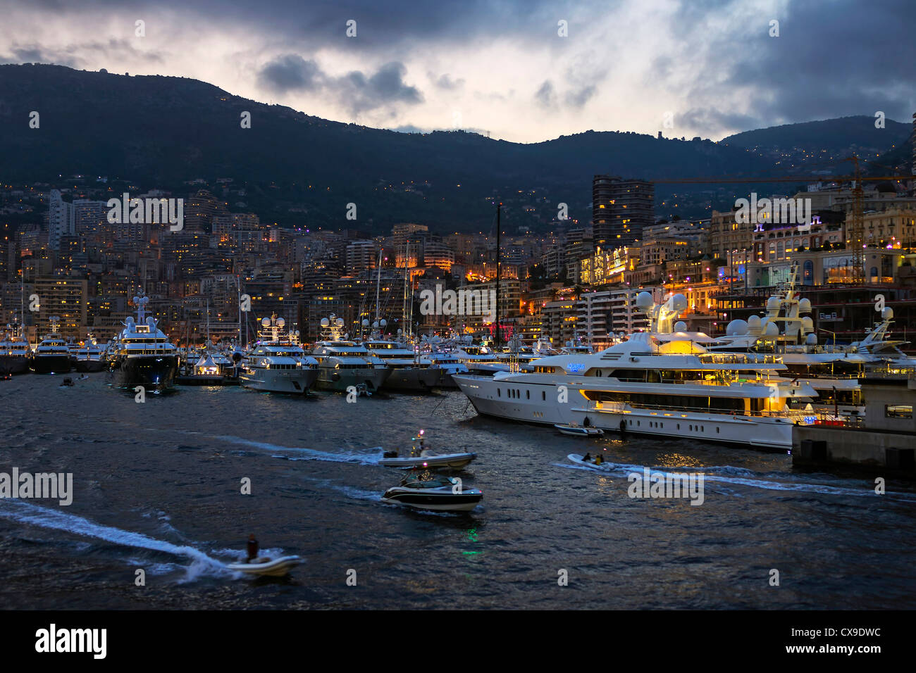 Monaco Port Hercule at Dusk during the 2012 Yacht Show - Stock Image