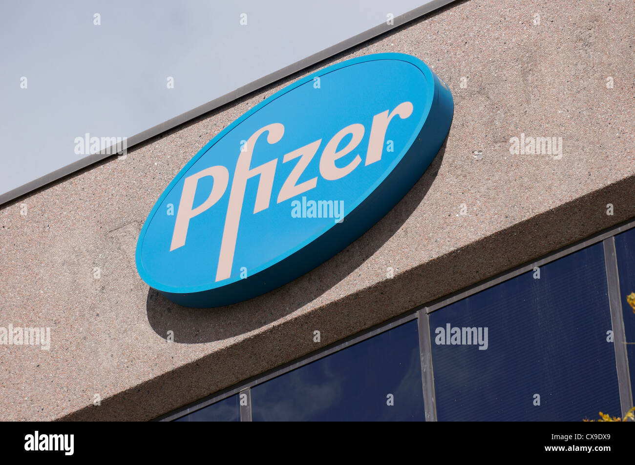 Pfizer pharmaceutical company sign, logo - Stock Image