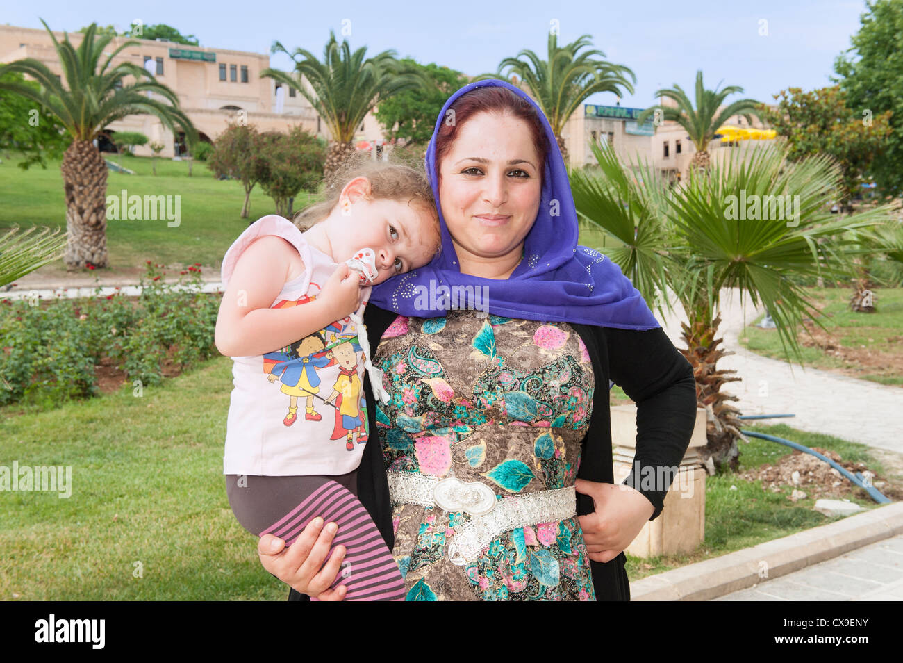 Woman with her child, Urfa, Eastern Turkey - Stock Image