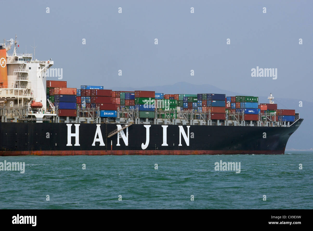 Portside of Hanjin container freighter traveling in the West Lamma Channel of Hong Kong, China. - Stock Image
