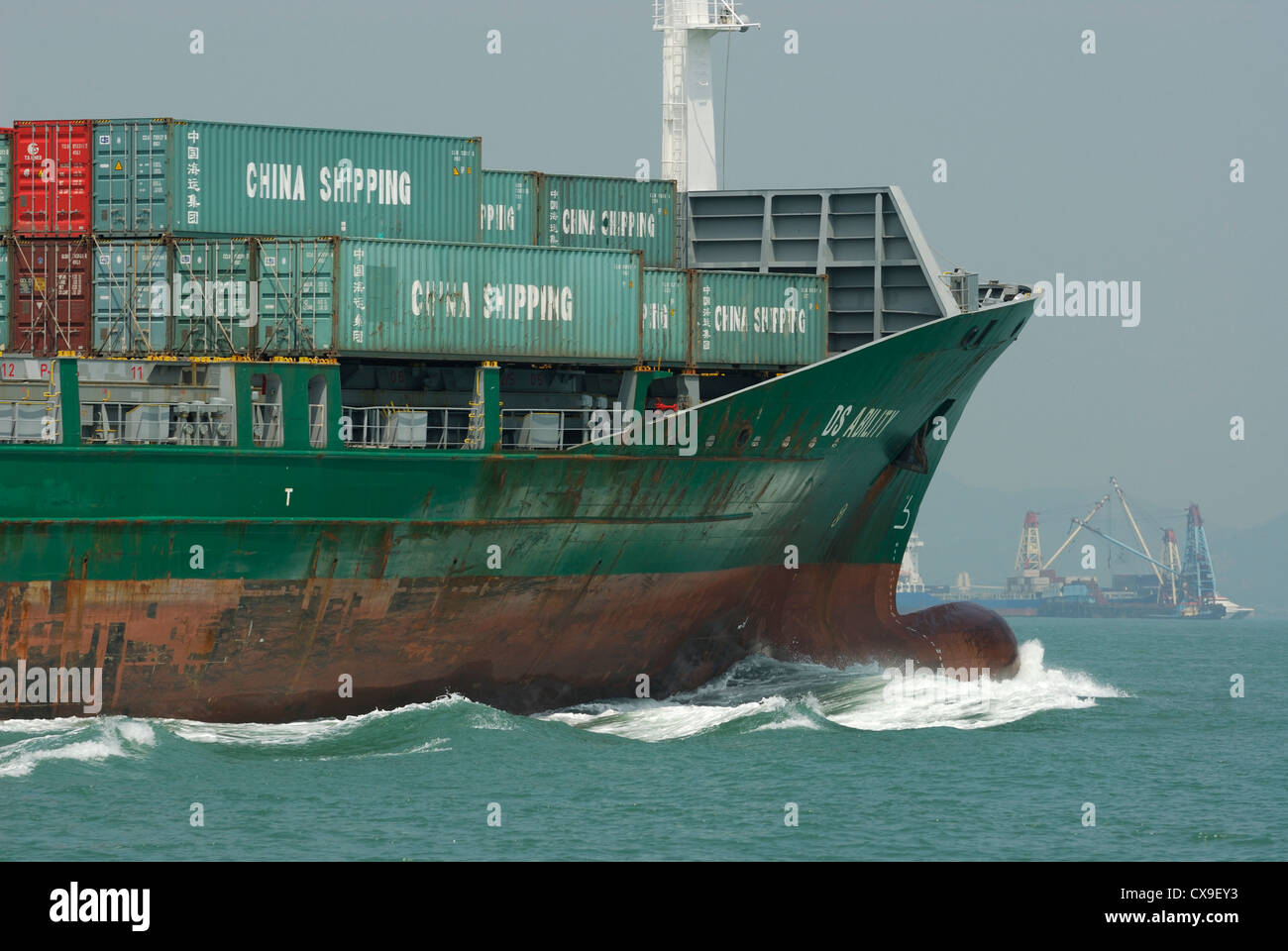 Portside bow of freighter traveling in the West Lamma Channel of Hong Kong, China. Stock Photo