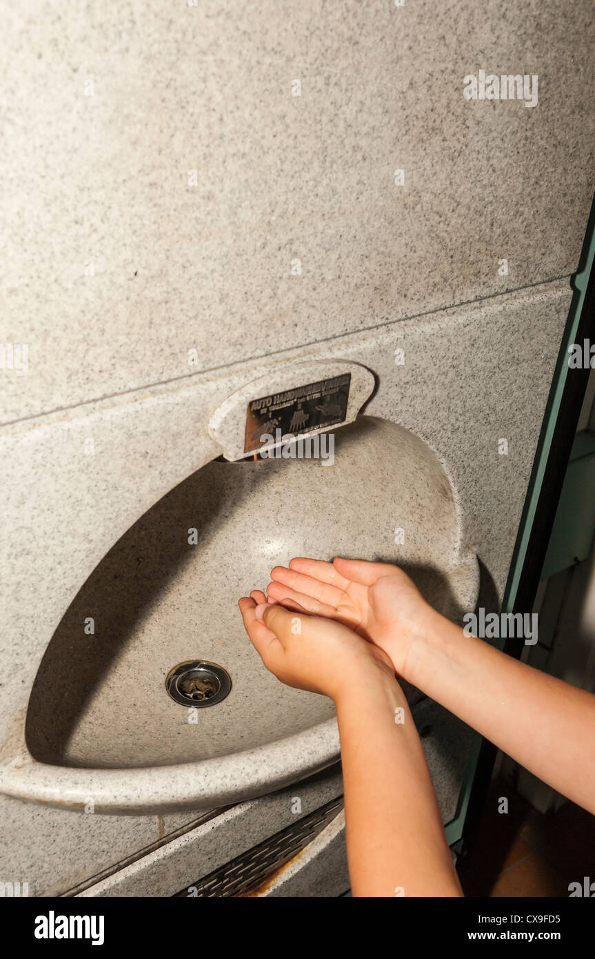 An Automatic Hand Washing Machine In A Public Toilet In