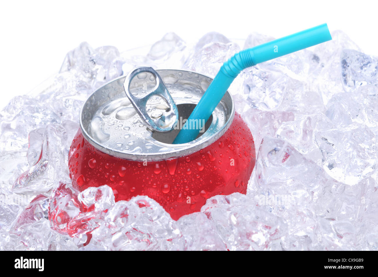 Single soda can in ice with drinking straw white background copy space - Stock Image