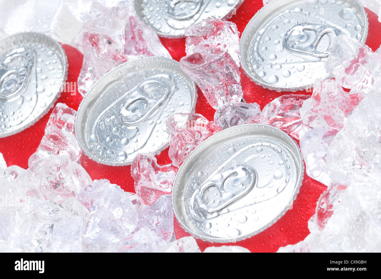Close Up of Soda Cans in Ice with Condensation - Stock Image