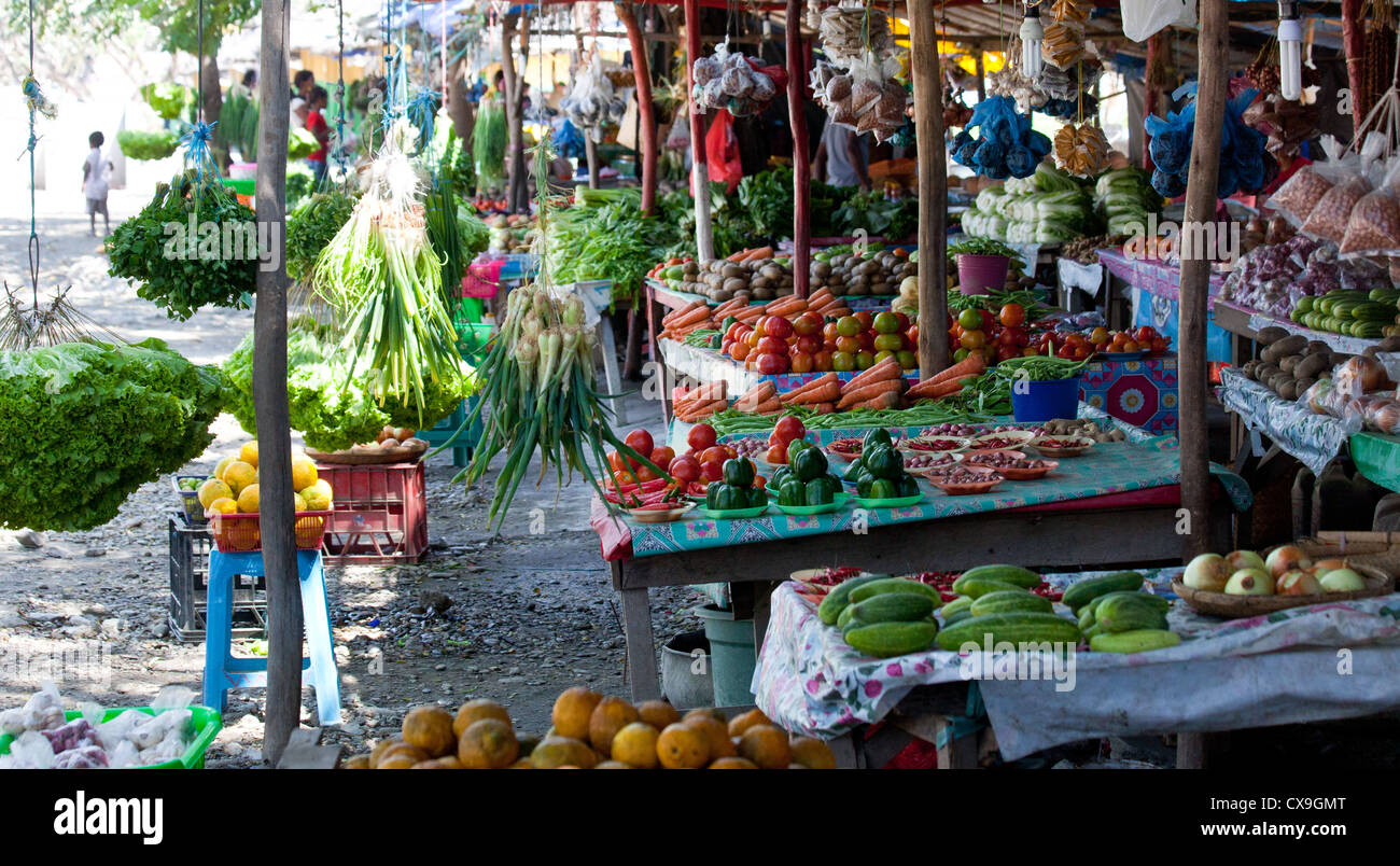 Local produce market selling colourful fruit and vegetables in Dili, East Timor - Stock Image