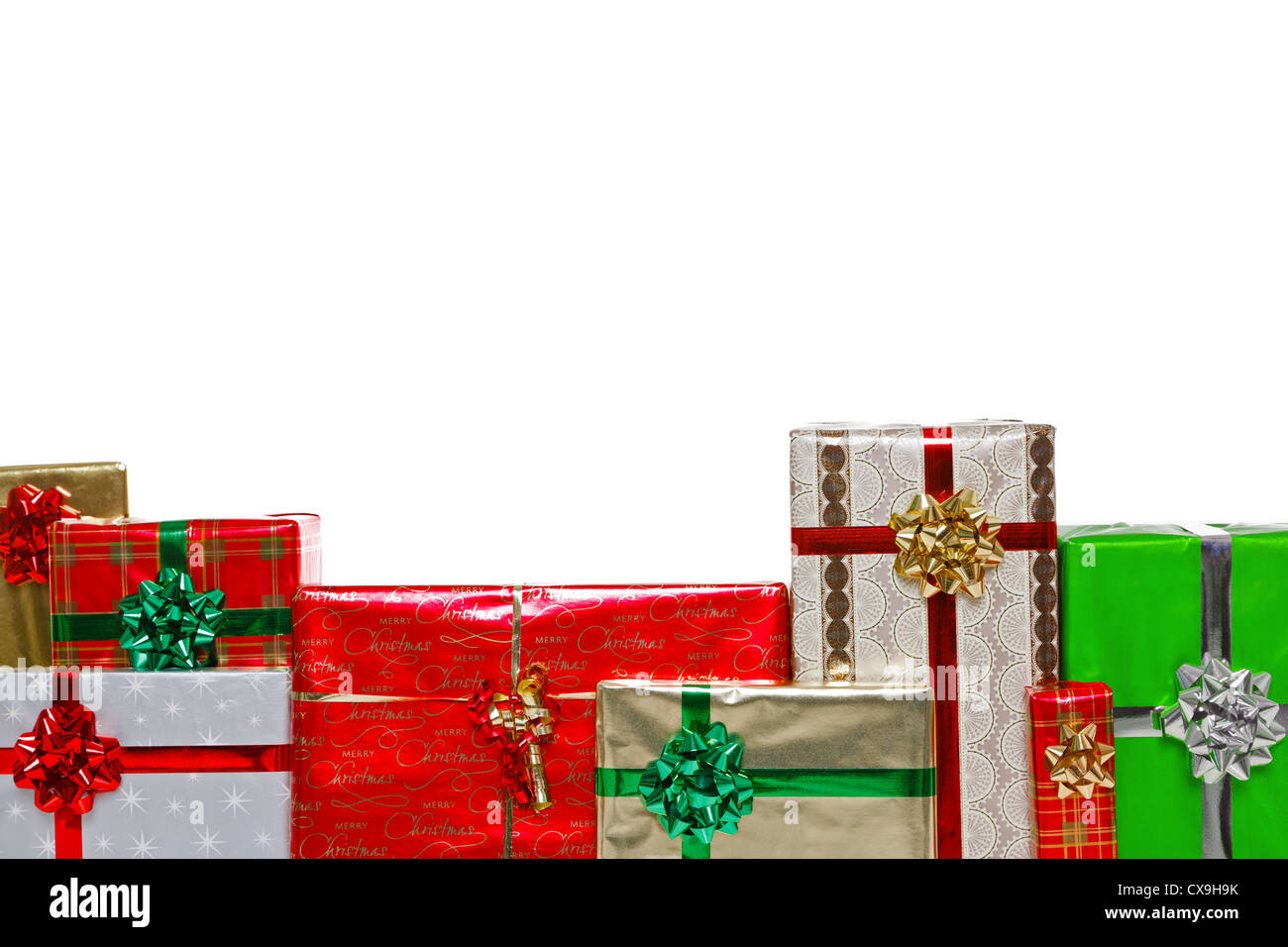 A group of gift wrapped Christmas presents with bows and ribbons - Stock Image