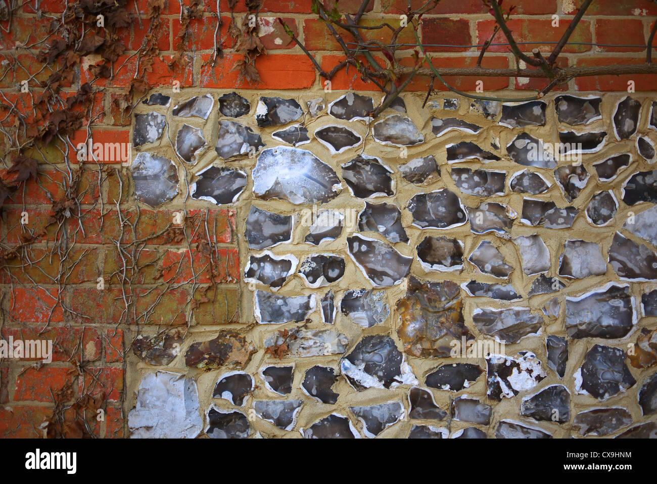 Flint and brick wall, Wiltshire, UK. - Stock Image