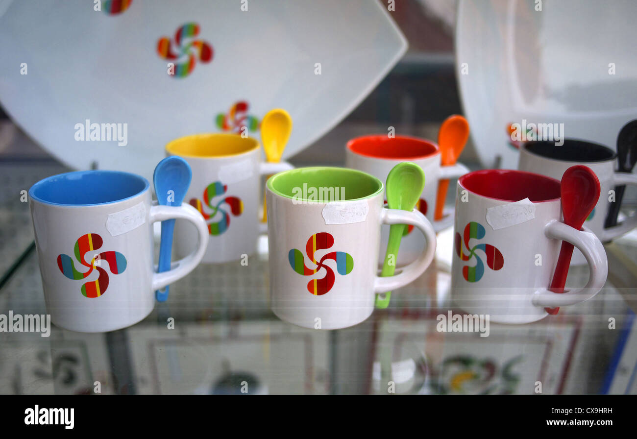 Mugs with the Basque symbol on sale in Saint Jean Pied du Port, France. - Stock Image