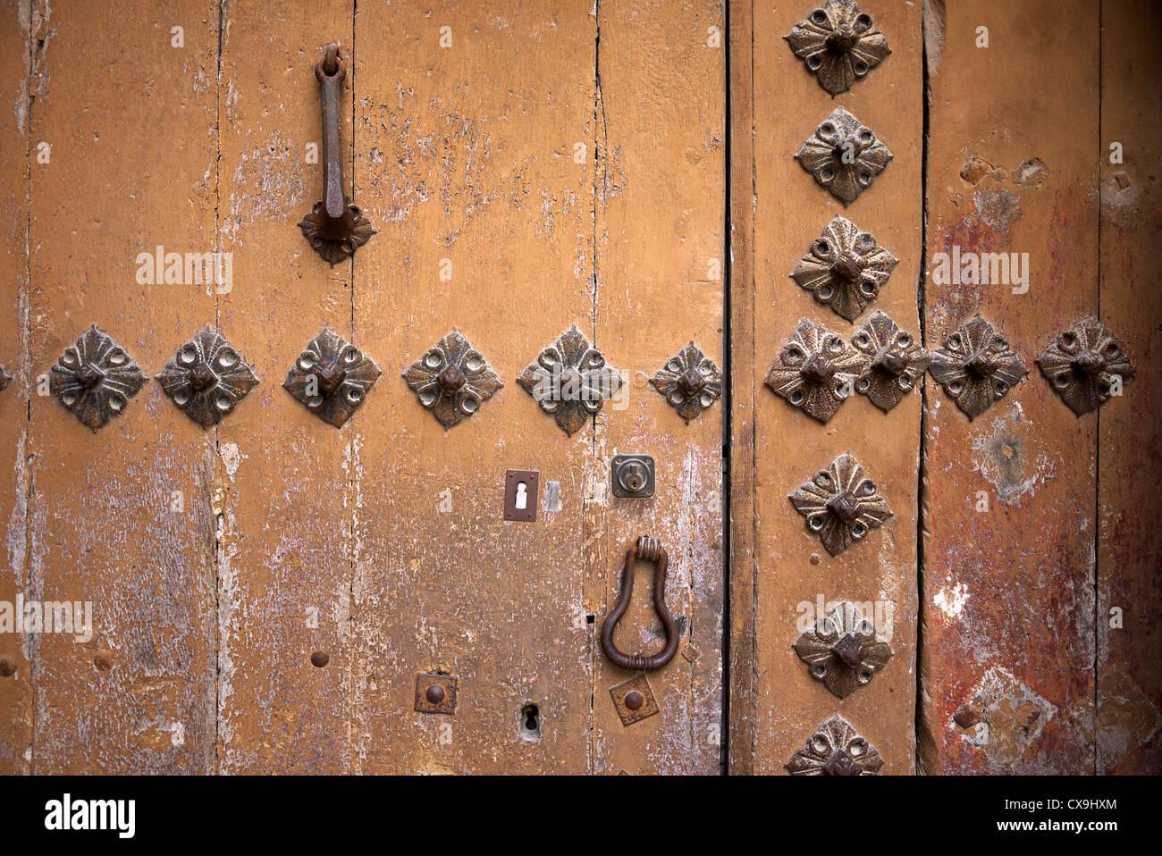 Old wooden door with metal rivets Spain. - Stock Image & Old Metal Door Rivets Stock Photos u0026 Old Metal Door Rivets Stock ...