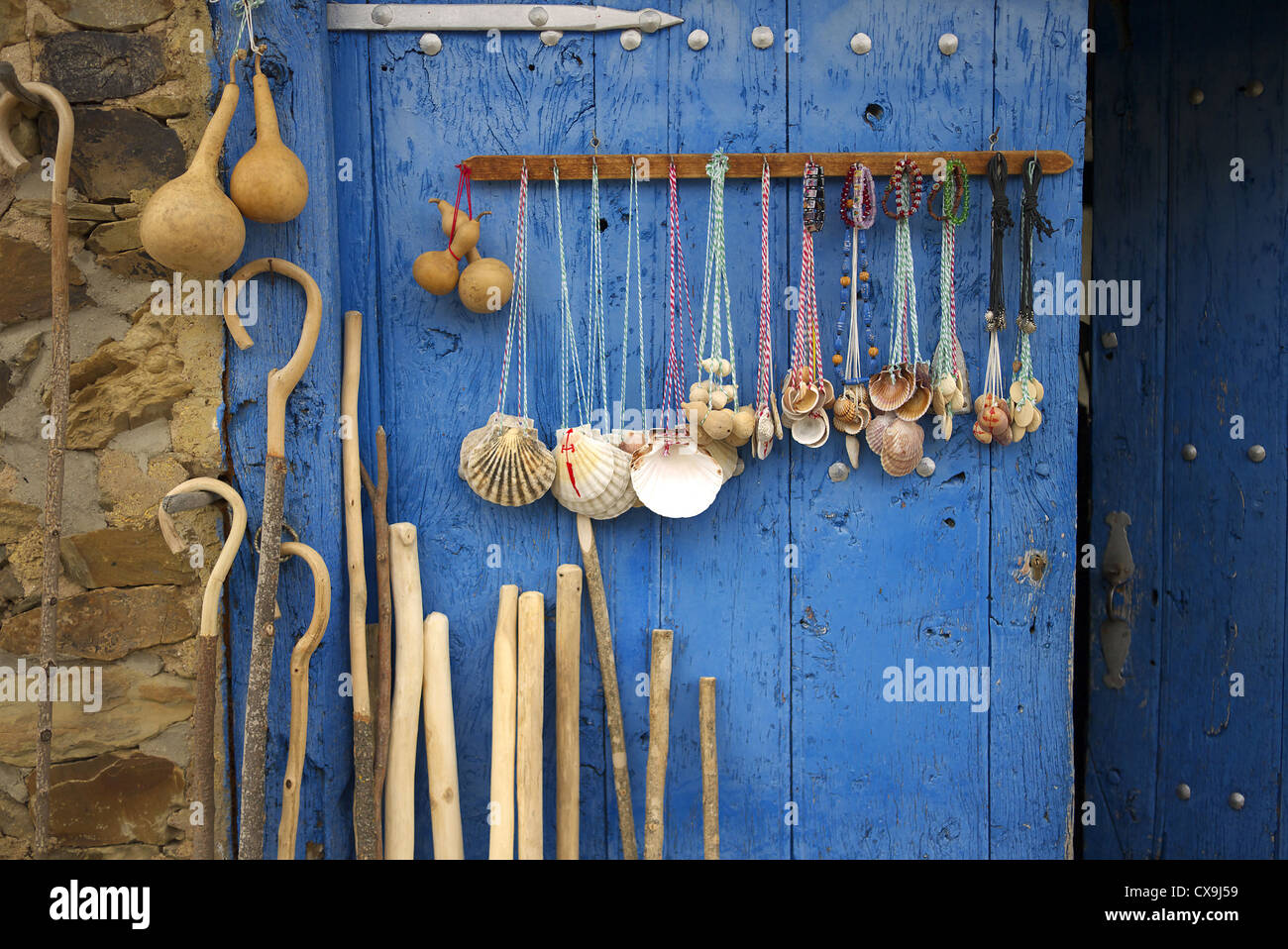 Scallop shells, walking sticks and camino souvenirs on sale along the camino in Spain. Stock Photo
