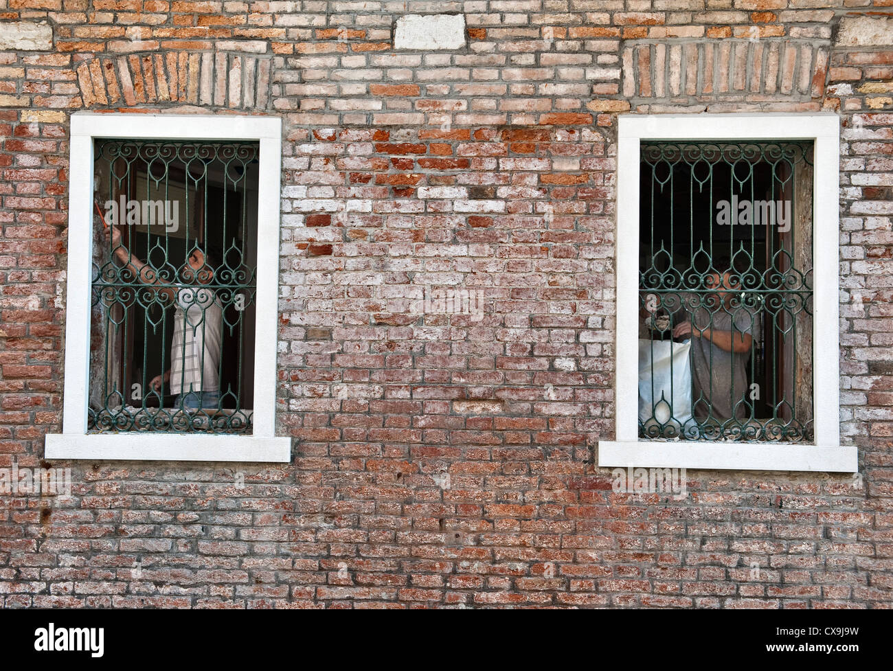Venice, Italy. Builders working on an old Venetian house - Stock Image
