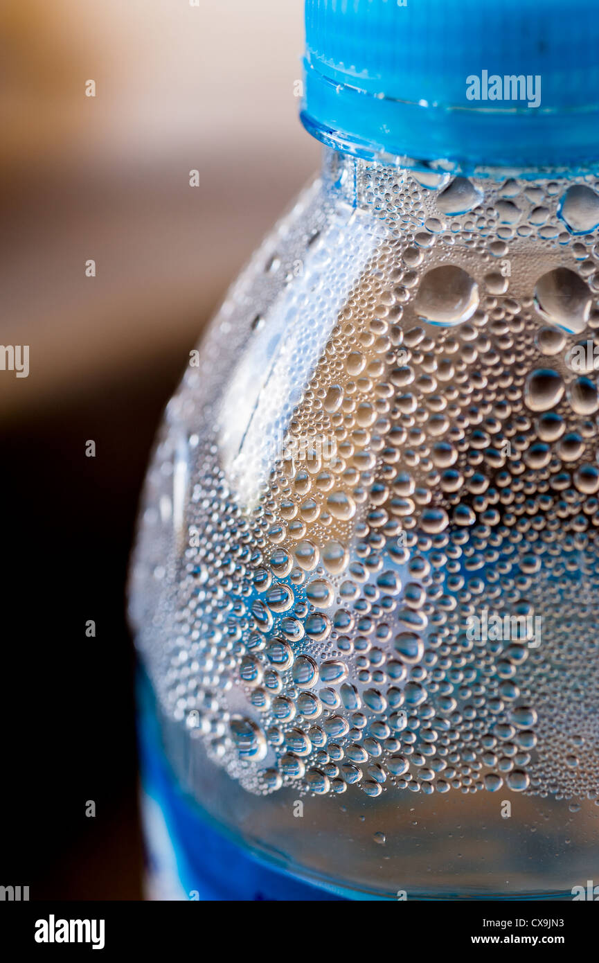 Drop of water on drinking water bottle - Stock Image