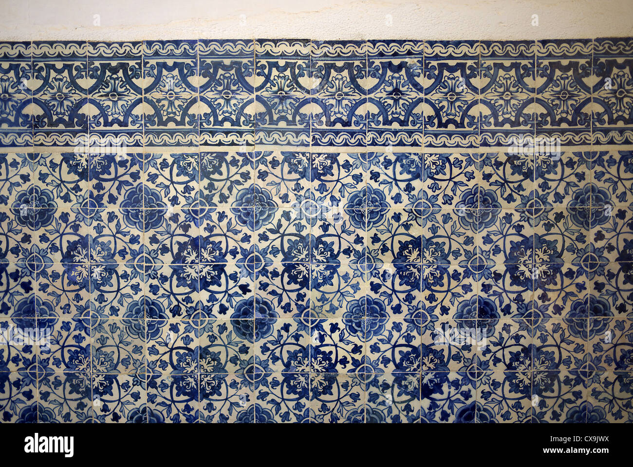 Detail of hand painted tiles in the Templar Castle in Tomar, Portugal. - Stock Image