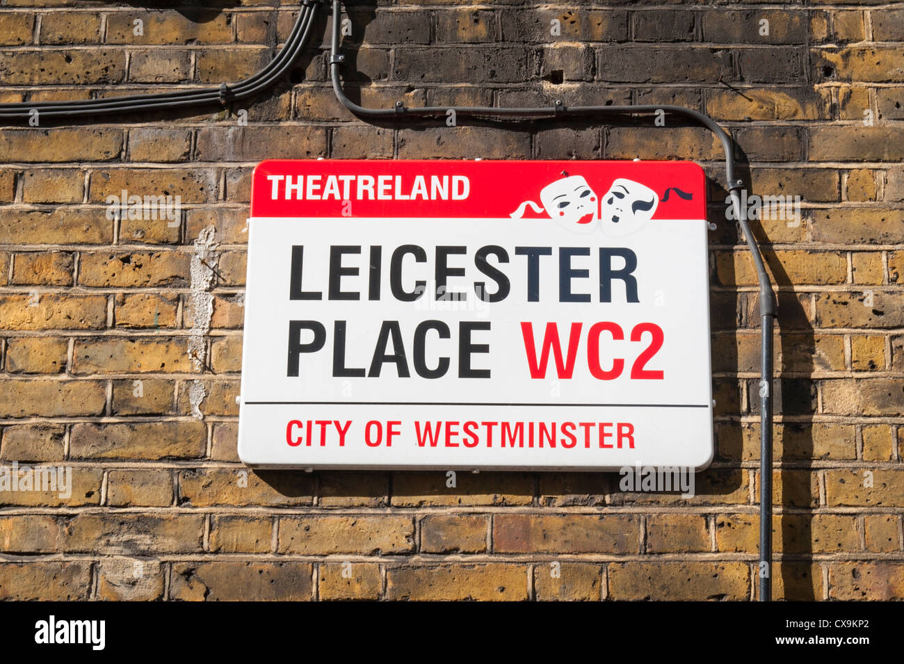 London West End Leicester Square Place Theatreland Theaterland street road sign brick wall - Stock Image