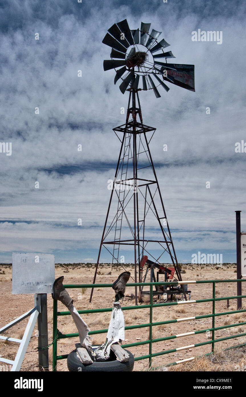 Old windmill and 'dead cowboy' at entrance to Bar W Ranch near Carrizozo, New Mexico, USA - Stock Image