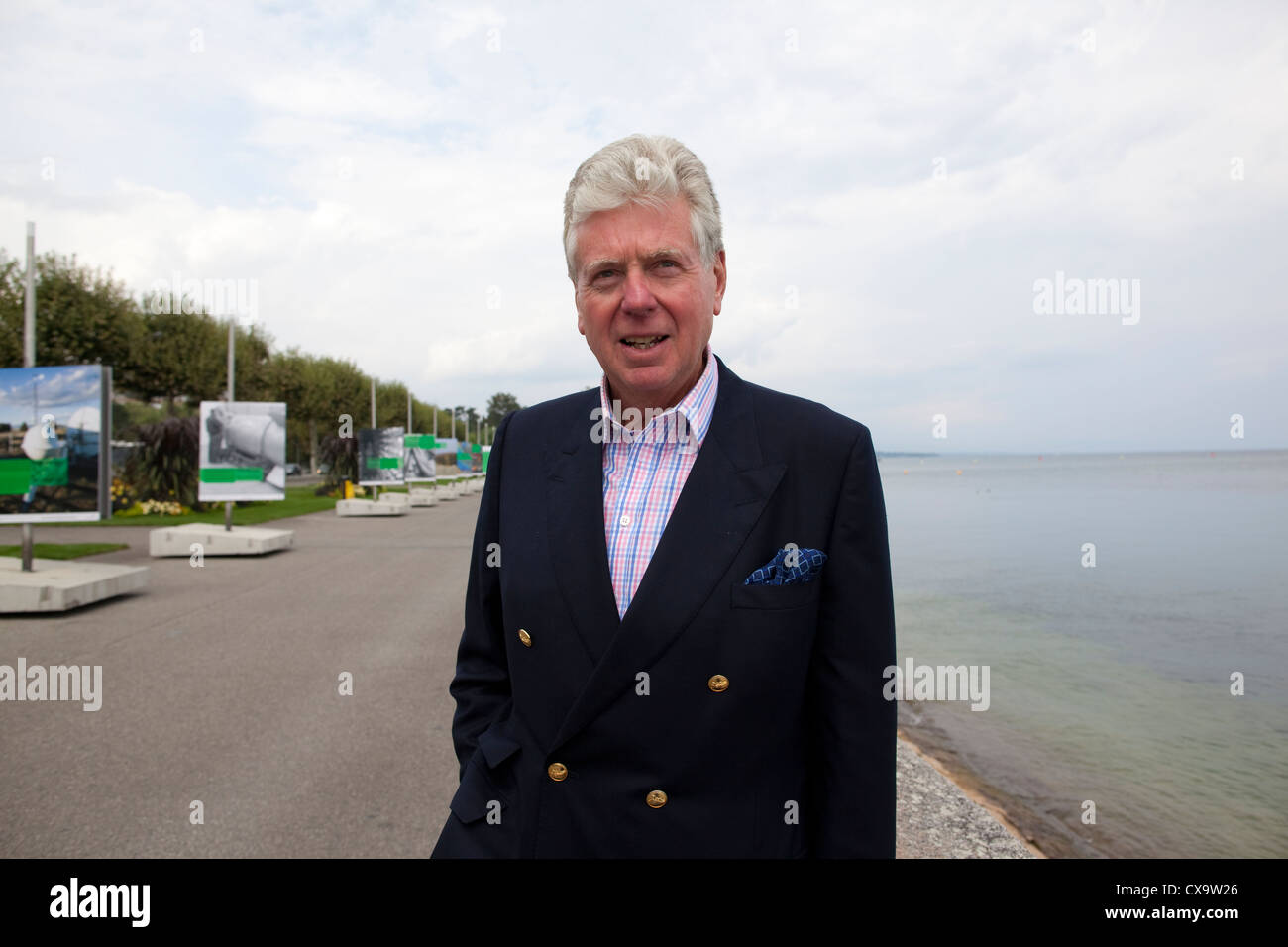 Michael Cole Director at Fulham FC taking a stroll along the edge of Lake Geneva, Switzerland - Stock Image