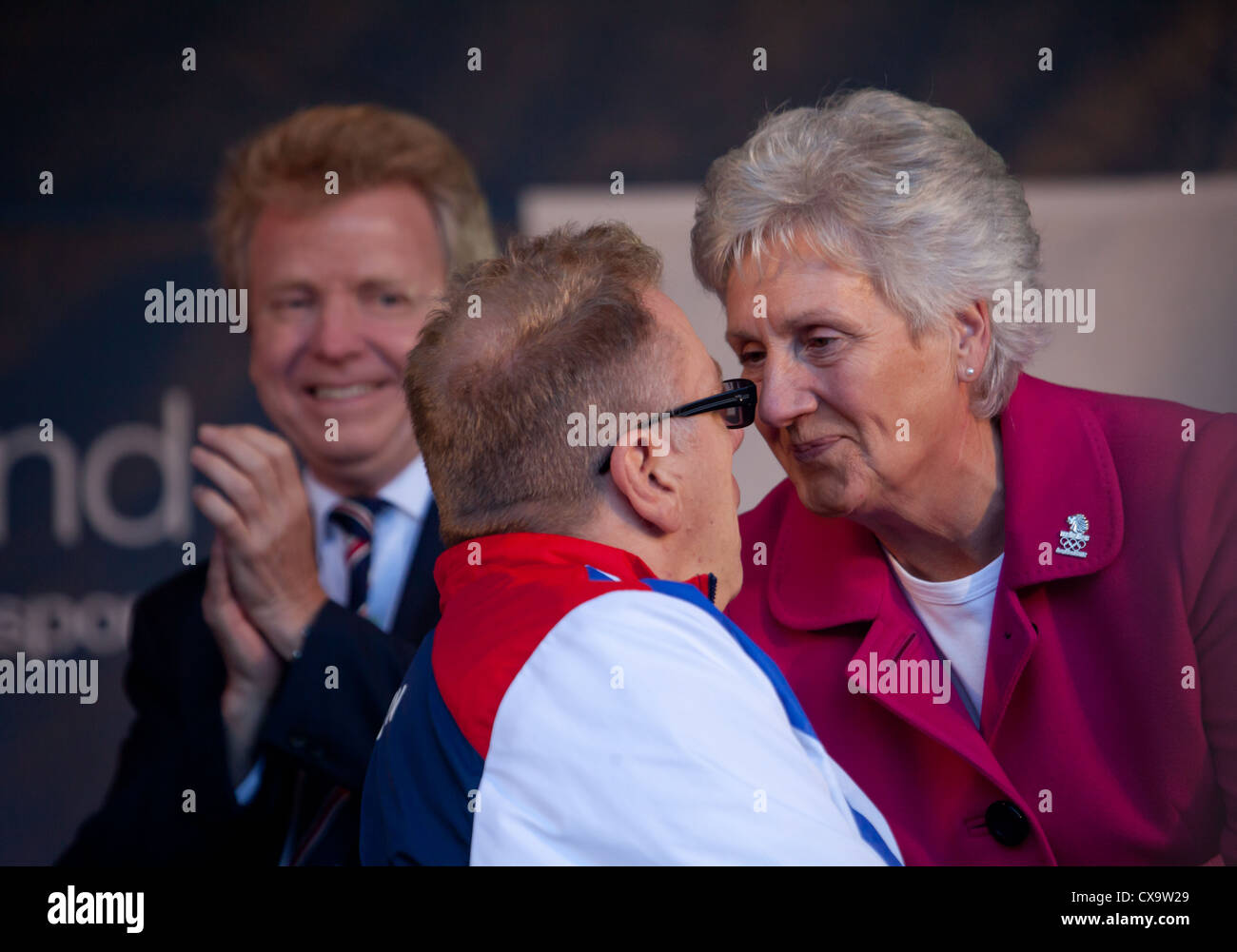 Jim 'The Swim' Anderson, veteran Scottish Team GB swimming paralympian chats with Louise Walsh CBE. Lord - Stock Image