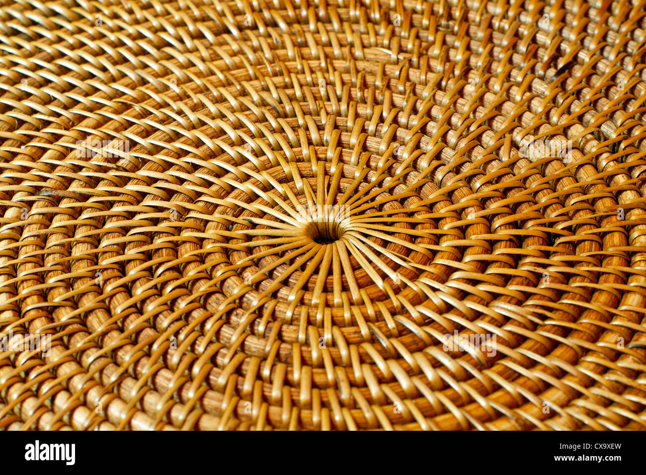 Concentric circular design horizontal, close up of woven wicker - Stock Image