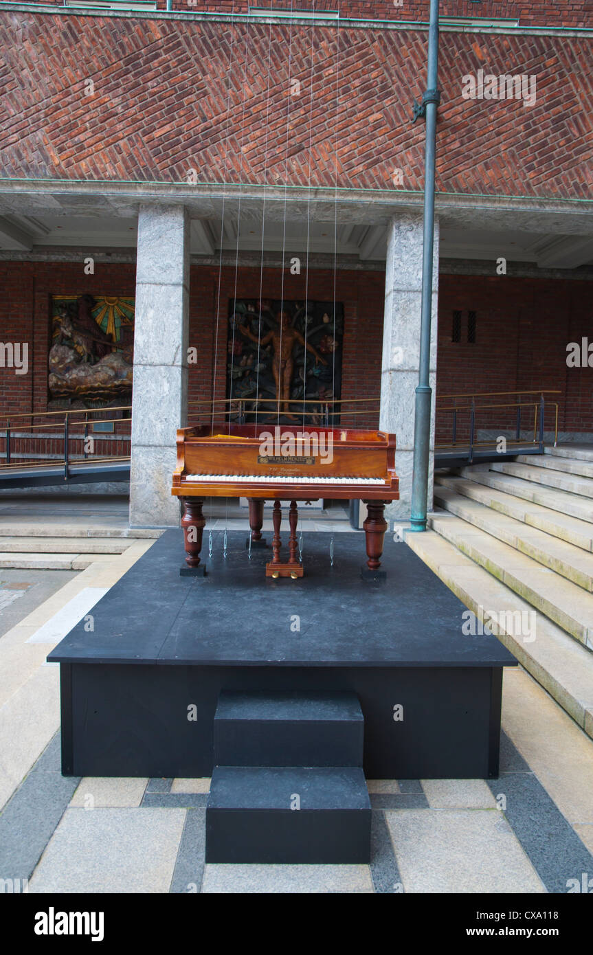 A Piano listening to Itself the Nordheim variation outside Rådhus the Town Hall Sentrum central Oslo Norway - Stock Image