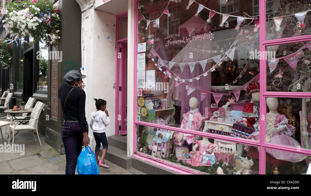 A woman and child outsid the pink Mystical Fairies shop on Flask Walk in Hampstead Village street in London NW3 - Stock Image