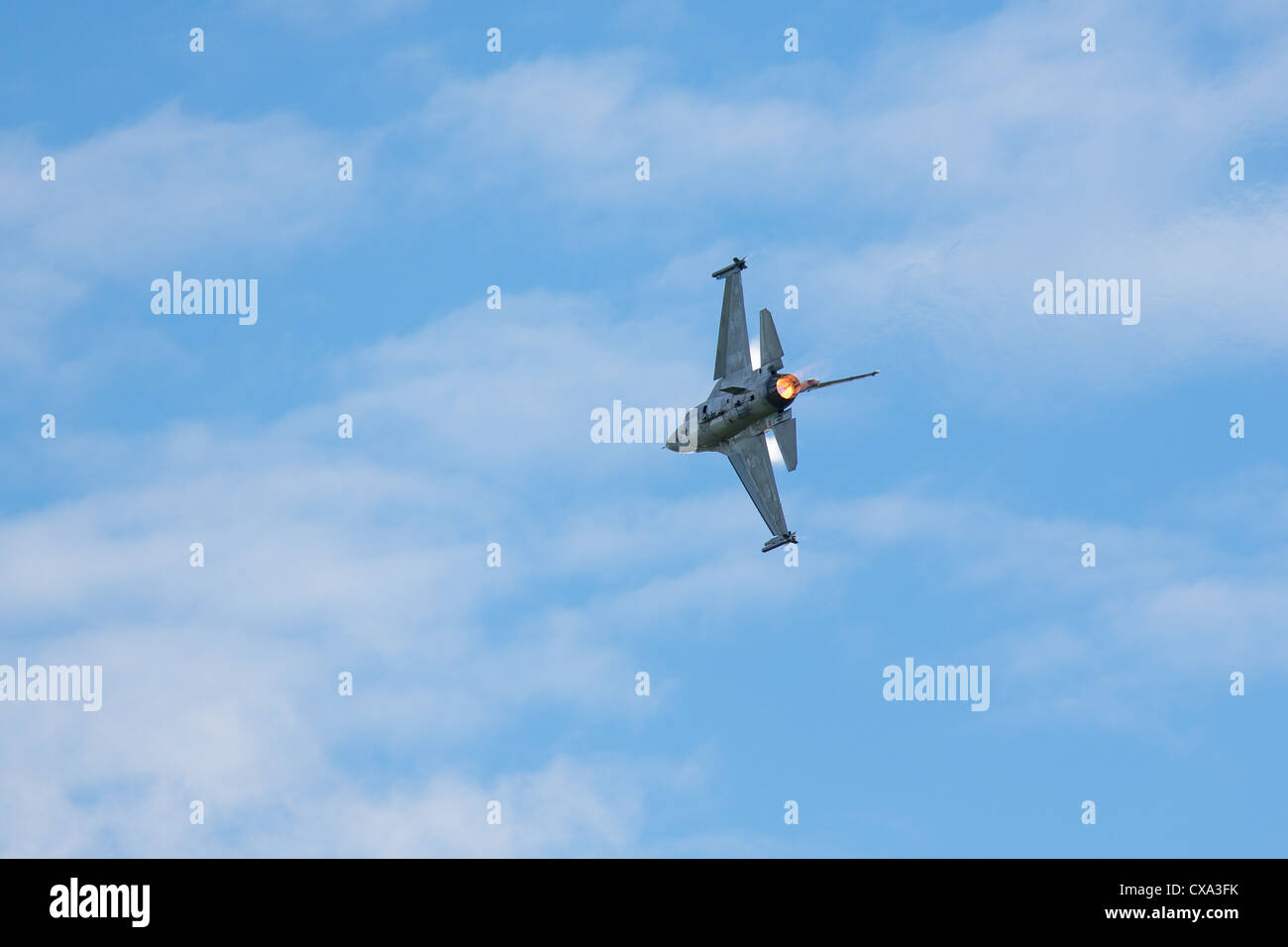 An F-16 figher jet performs at an airshow Stock Photo