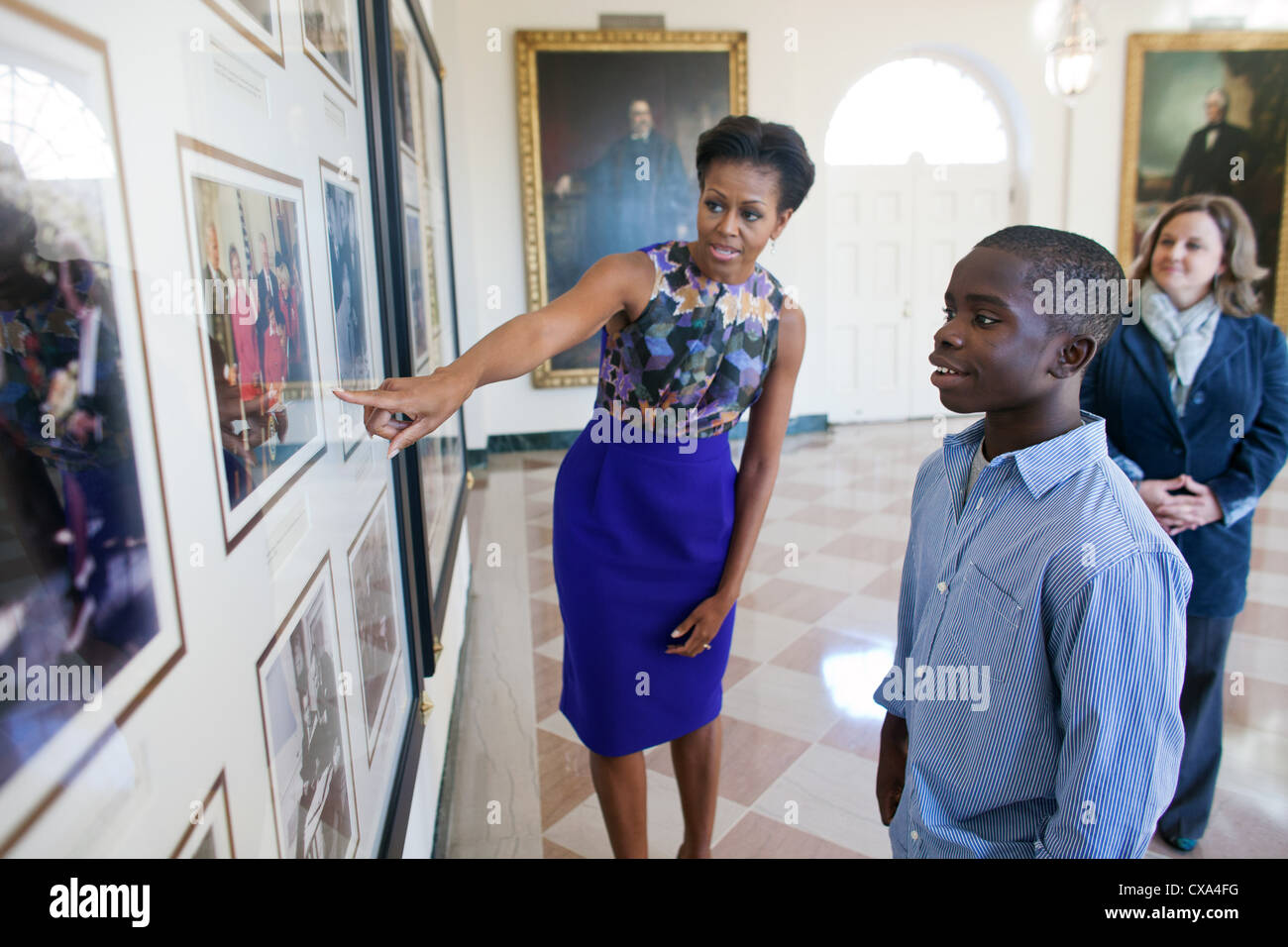 Michelle Obama shows NFL Super Kid James Gale, 11, historical photos from previous administrations. - Stock Image