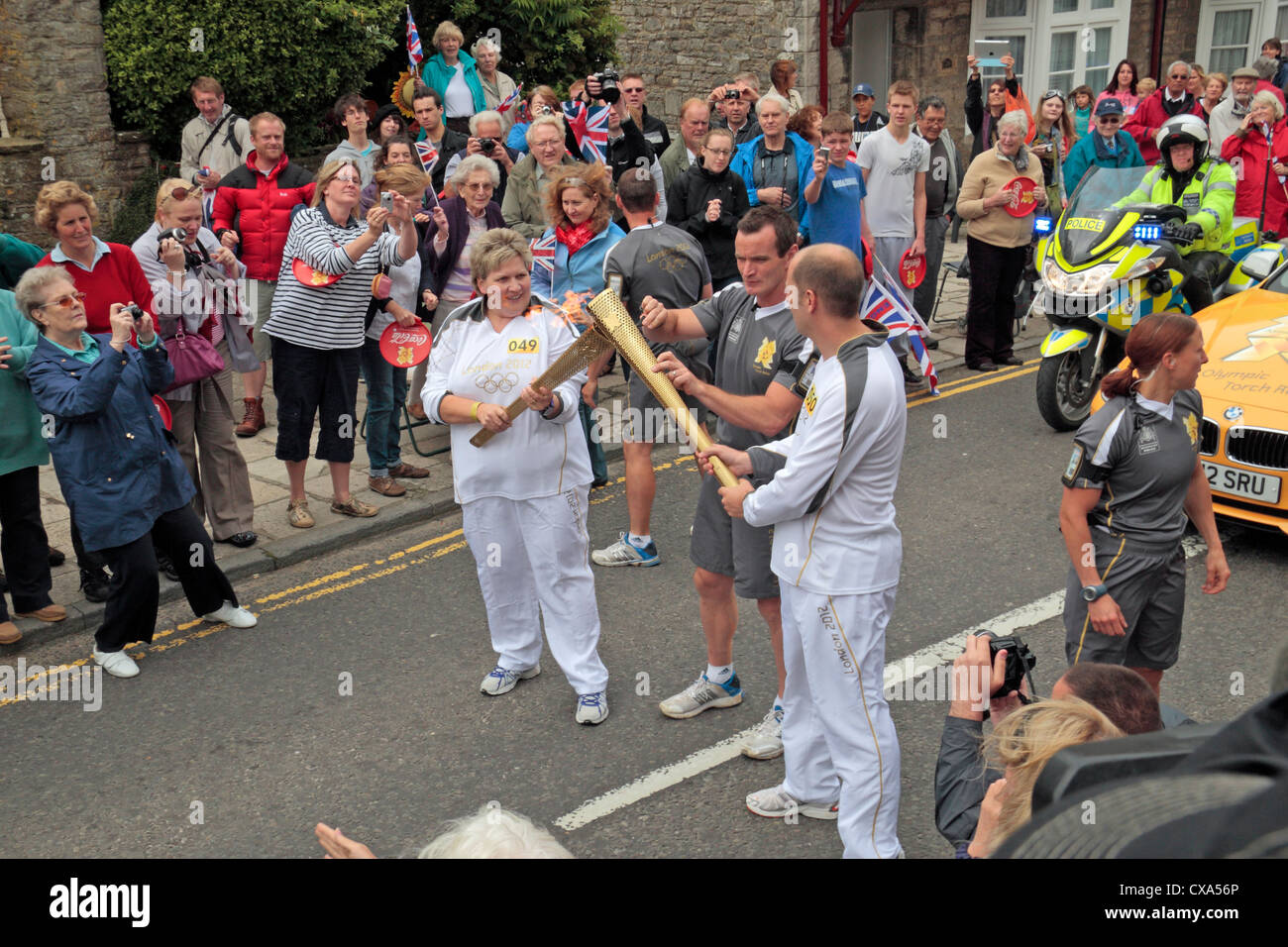 Handover point of the 2012 Olympic Games torch relay in Corfe Castle, Dorset, UK. (13th July 2012) - Stock Image