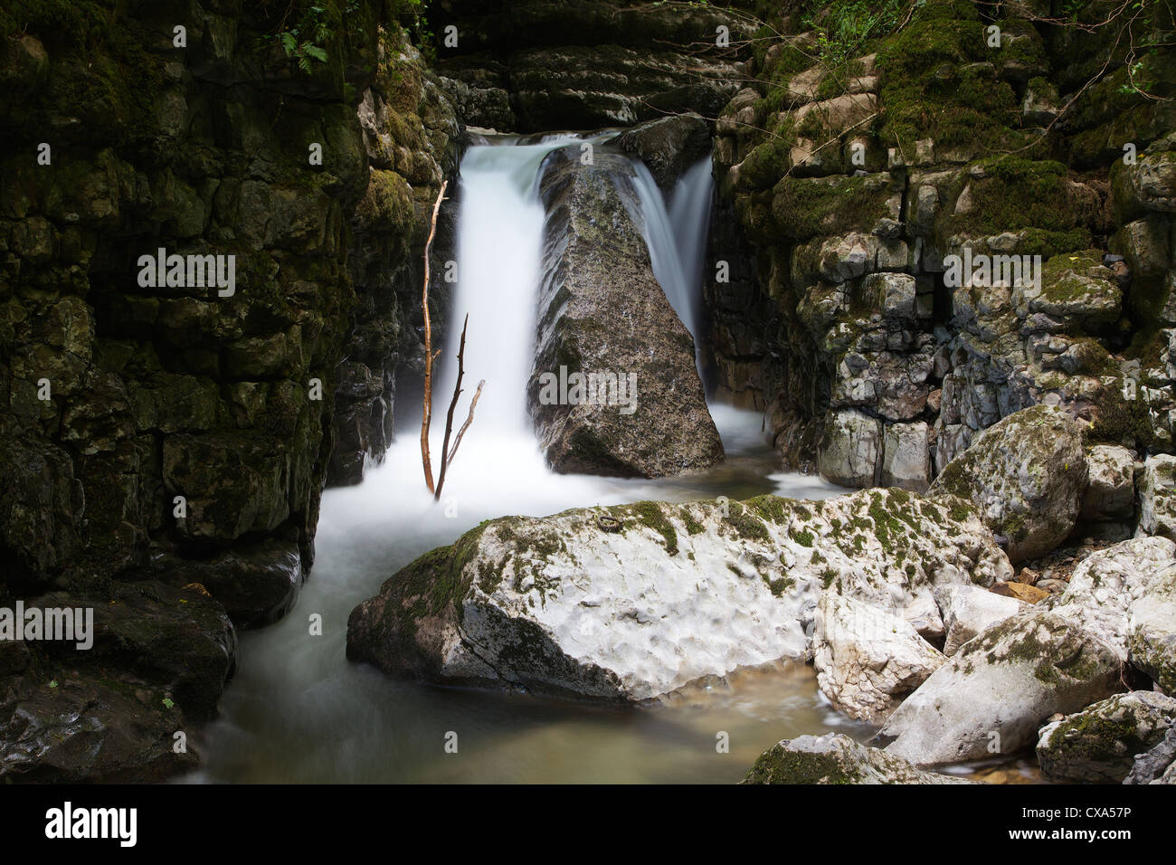 Waterfall in limestone gully at The Howk, Caldbeck, Lake District, Cumbria, England, UK - Stock Image