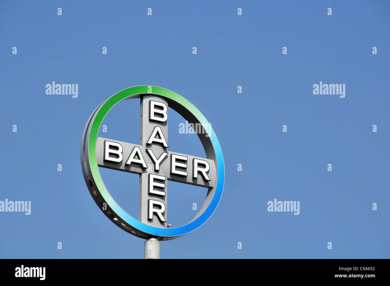 Bayer cross logo on top of a tower Berlin Germany - Stock Image