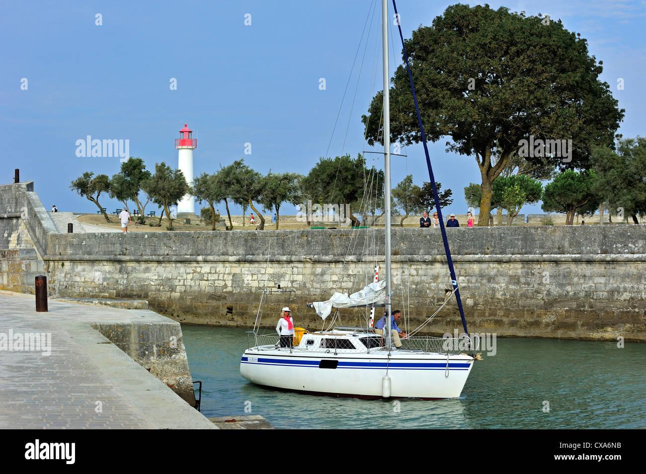 Sailing boat entering the port of Saint-Martin-de-Ré on the island Ile de Ré, Charente Maritime, Poitou-Charentes, Stock Photo