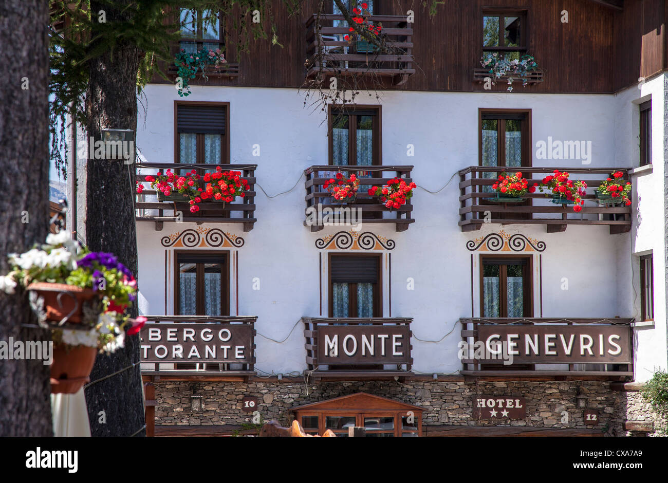 Hotel in Italy with floral balconies, Sauze d'Oulx, Italy - Stock Image