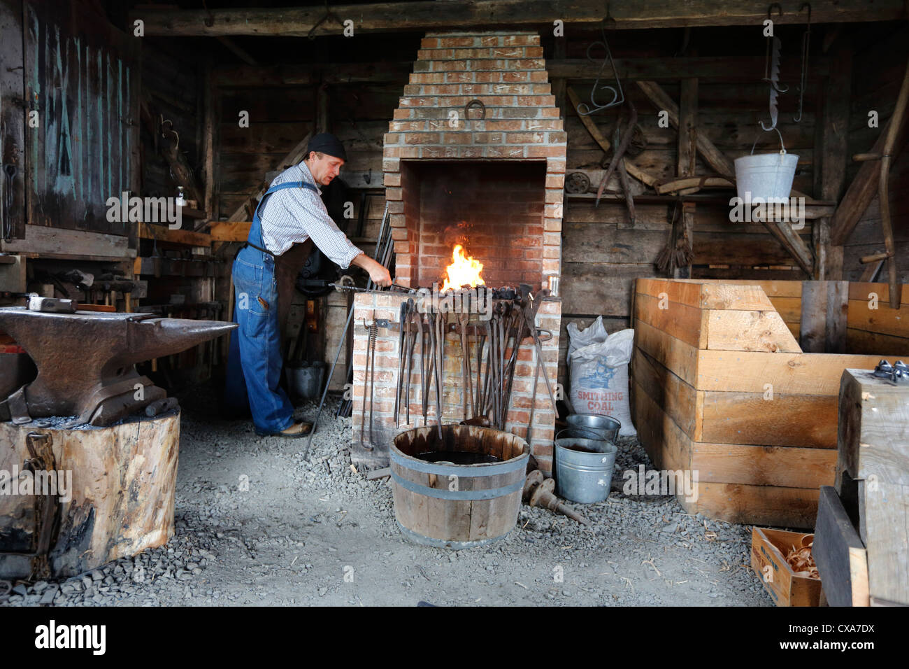 Blacksmith At Forge Historical Acadian Village A Re