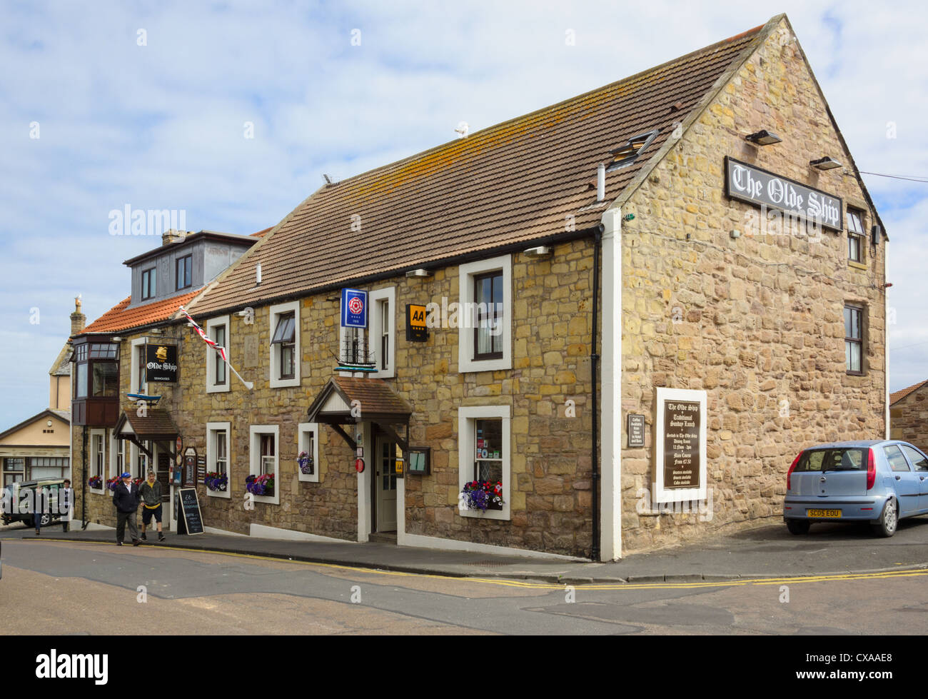 A traditional village pub in the small coastal village of Seahouses, Northumberland. - Stock Image