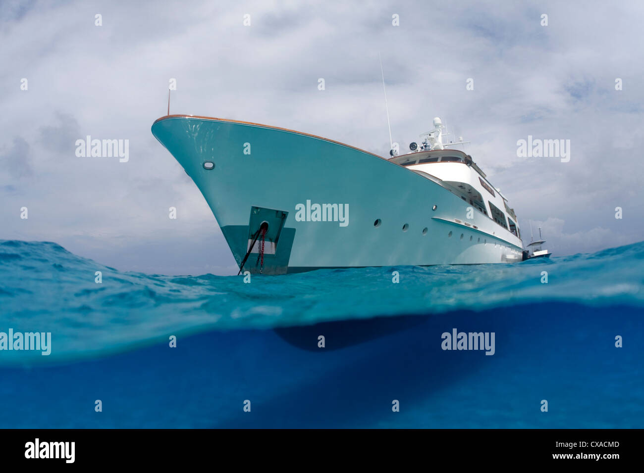 A split water view of a yacht in the Bahamas. - Stock Image