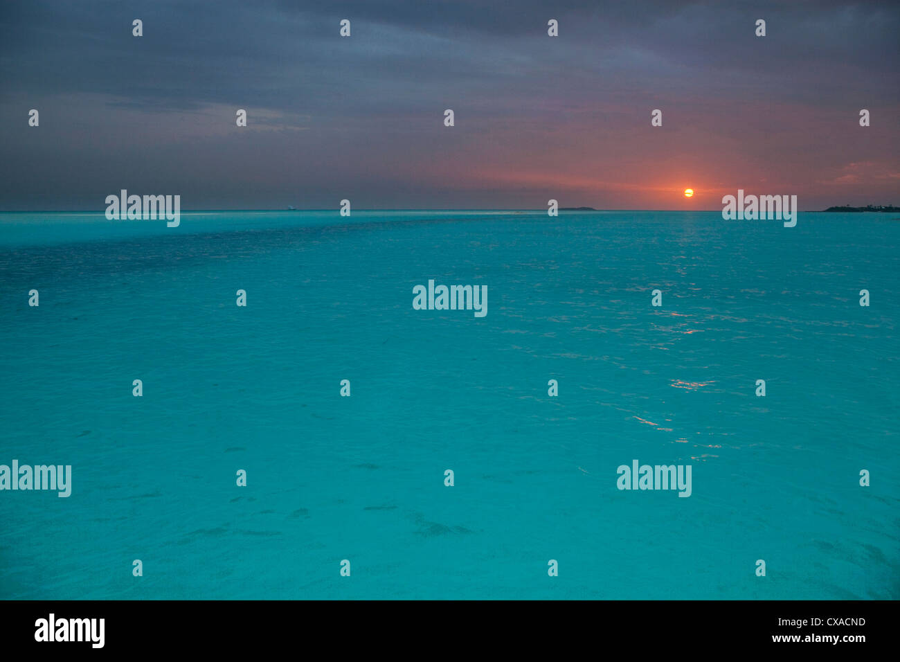 Sunset at Hawksbill Cay in the Bahamas. - Stock Image