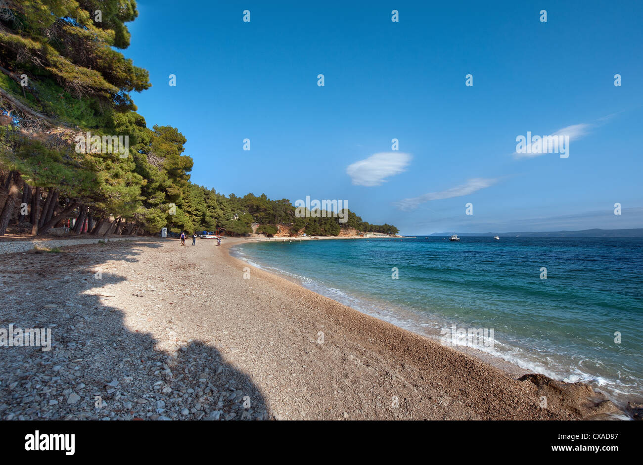 A beautiful sunny at the beach of Zlatni Rat (Golden Horn) near the town of Bol on the Adriatic island of Brač in - Stock Image