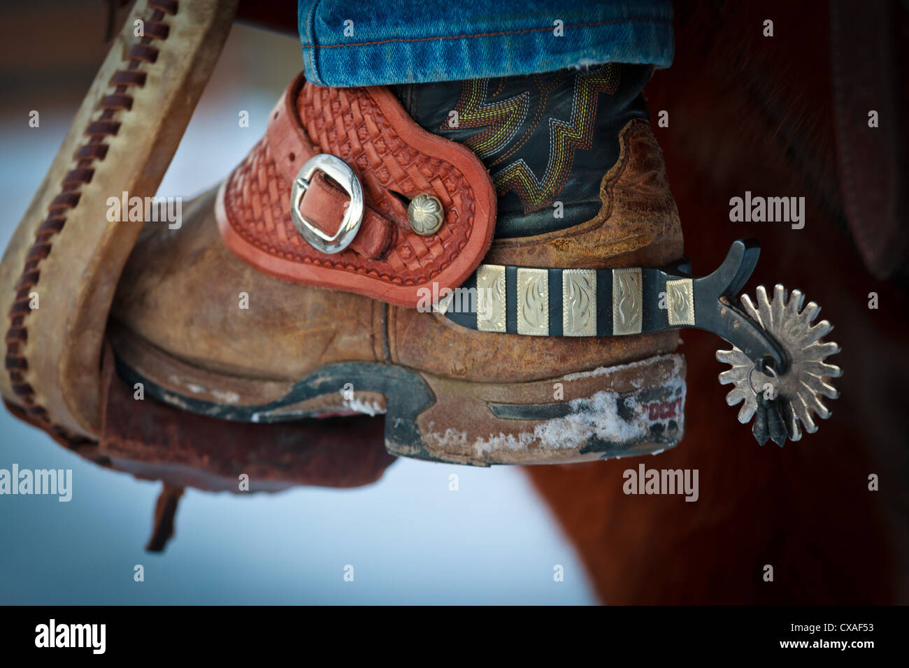 Boot with spurs in stirrup on ranch in eastern Wyoming - Stock Image