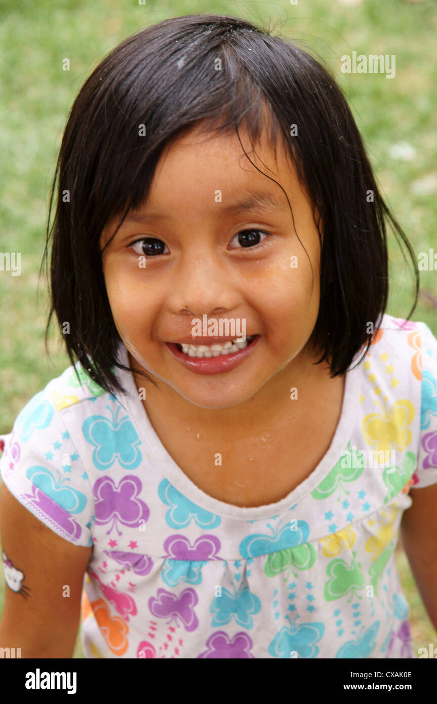 portrait headshot of cute hispanic latino girl baby with messy face