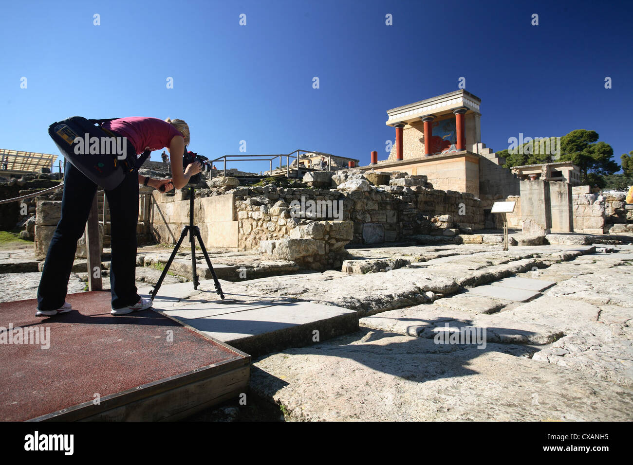 Knossos, young woman photographed the remains of the palace - Stock Image