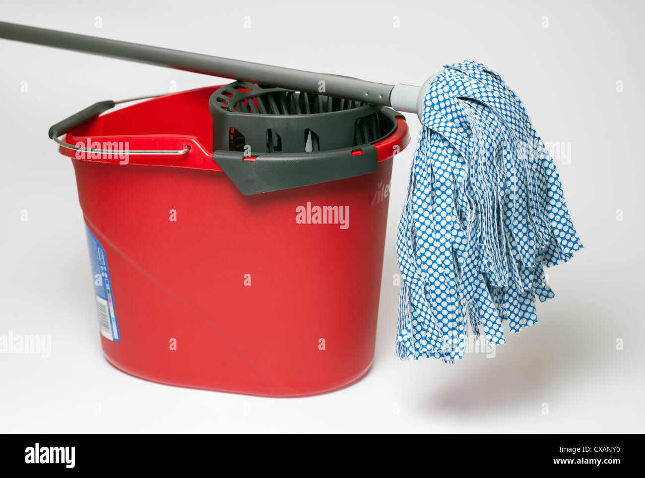 Red mop bucket and mop - Stock Image