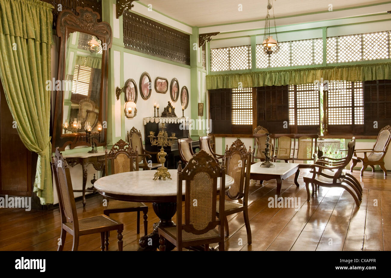 Main sala of the Pastor Heritage House dating from 1883, a classic Filipino style Bahay na bato in Batangas, Philippines - Stock Image