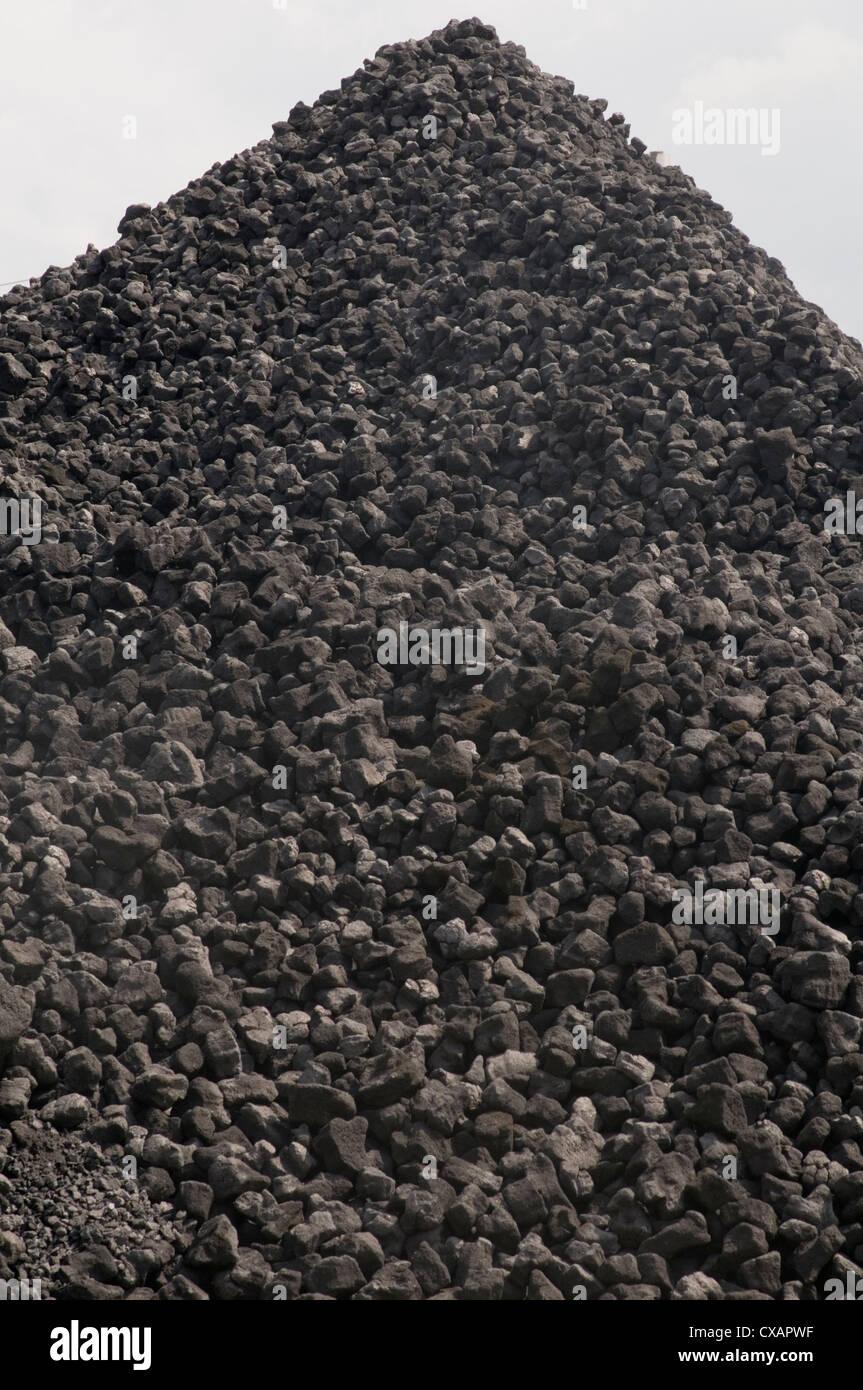 coal stocks pile of lump lumps reserves black bunker bunkers coalbunker coalbunkers - Stock Image