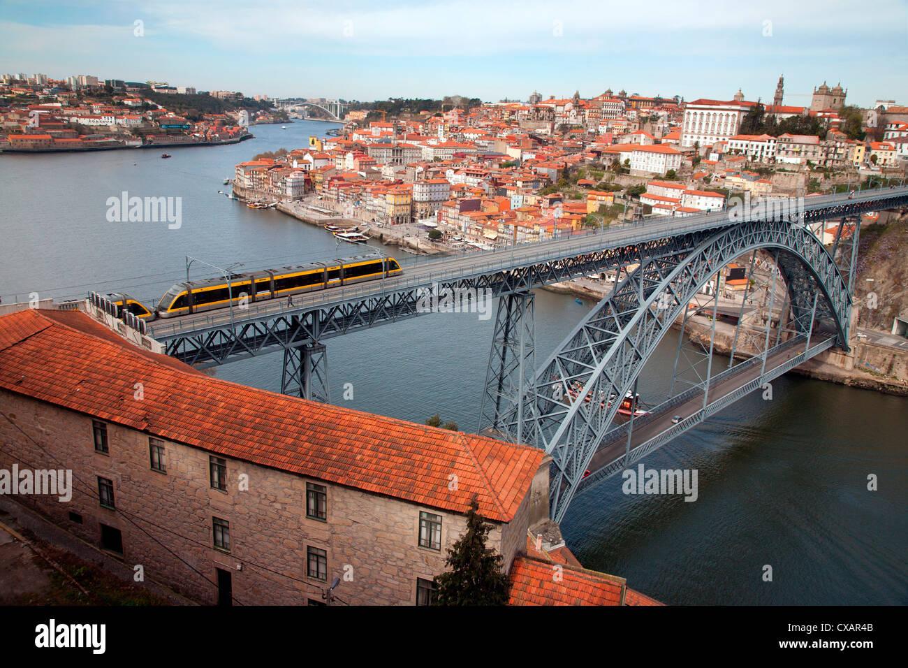 The Dom Luis 1 Bridge over the River Douro showing Metro light rail in transit and Arrabida Bridge in background, - Stock Image