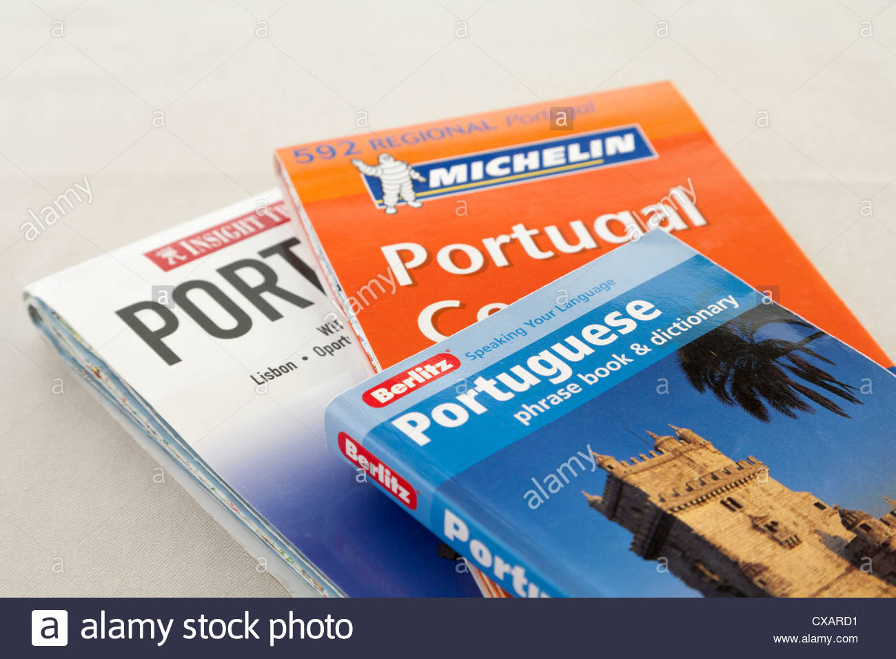 two maps of Portugal and a Berlitz Portuguese Phrase book and dictionary Stock Photo