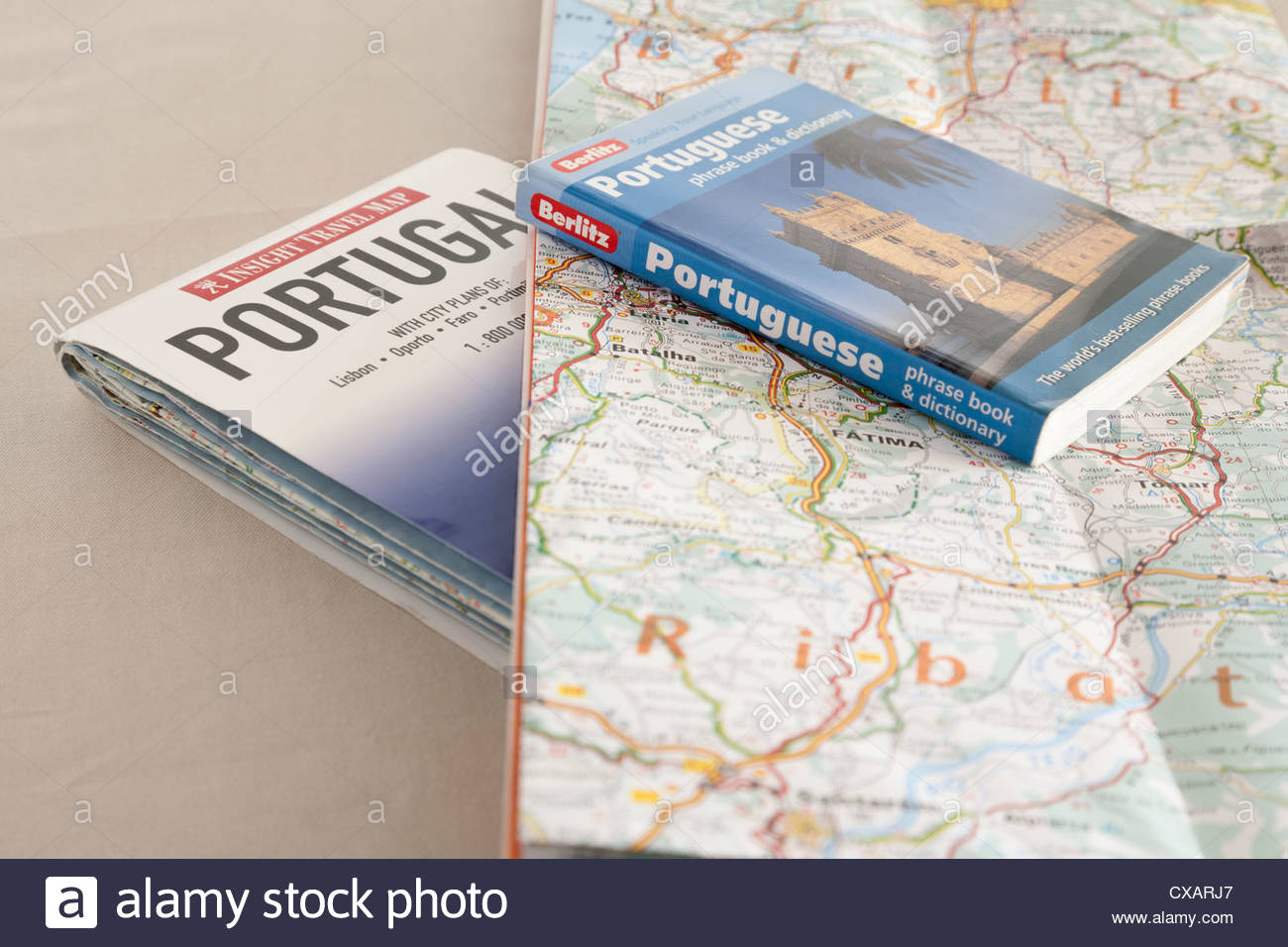 two maps of Portugal and a Berlitz Portuguese Phrase book and dictionary - Stock Image