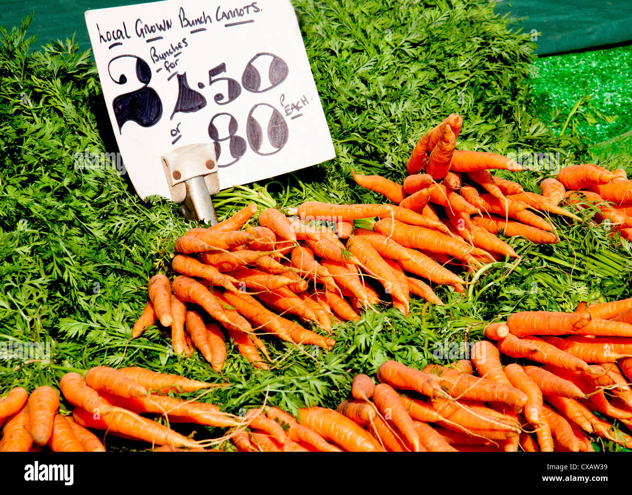 Carots on display in a market stall Stock Photo