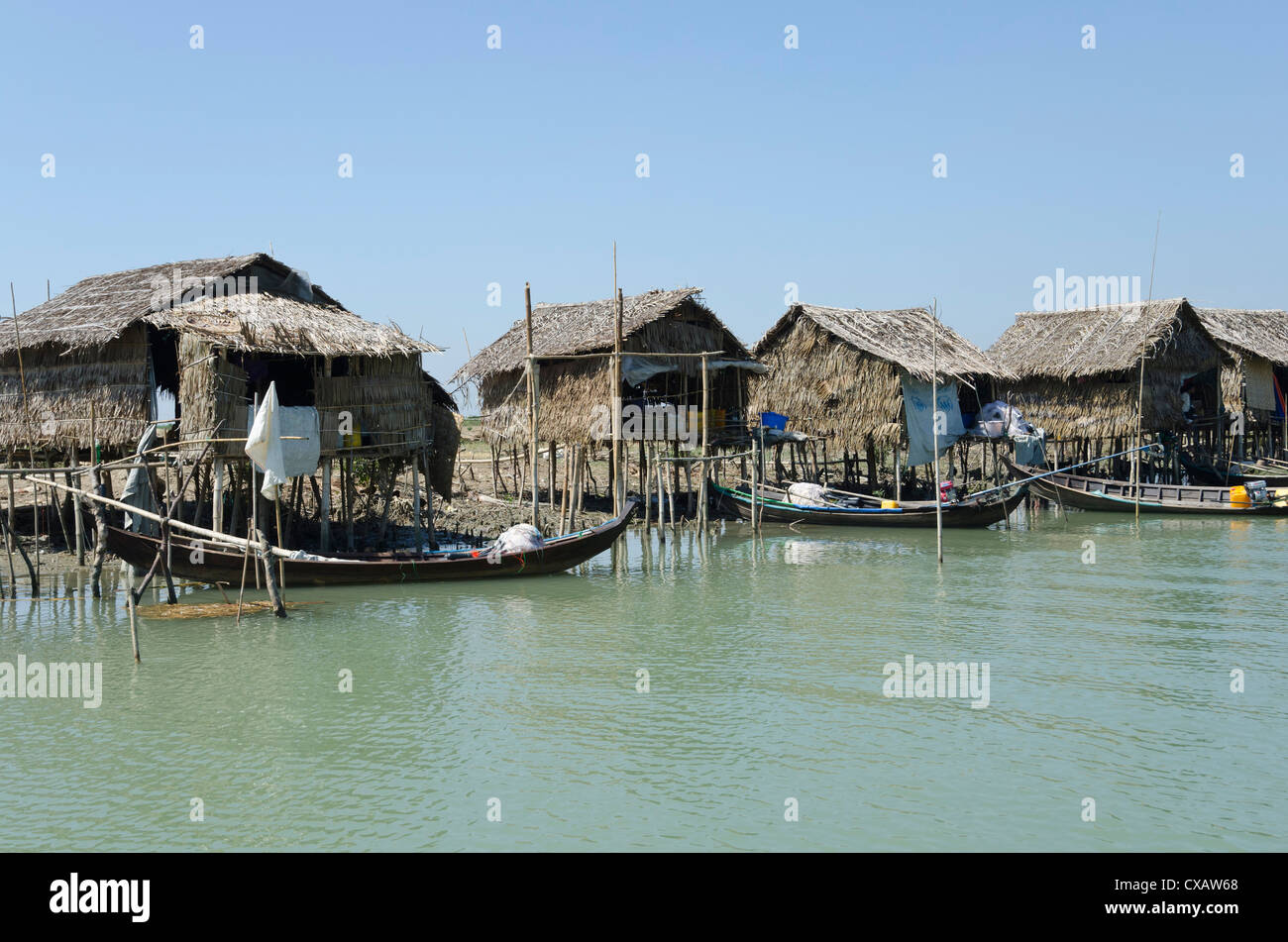 Bamboo huts and boats along a waterway, Irrawaddy delta, Myanmar (Burma), Asia Stock Photo