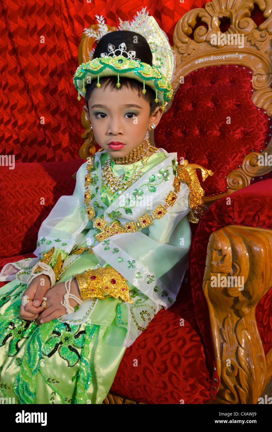Young boy pausing during his noviciation ceremony, Taungyi, Shan State, Myanmar (Burma), Asia - Stock Image